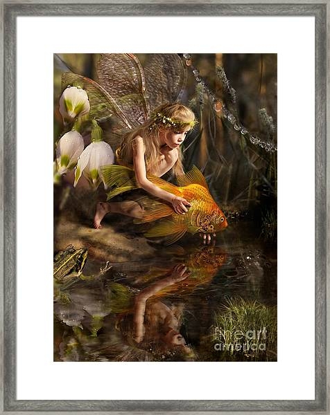The Girl Releases A Gold Fish Framed Print