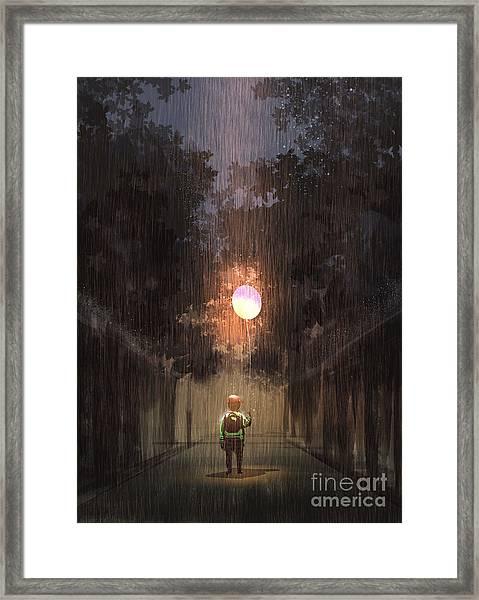 The Little Boy Holding A Bulb Balloon Framed Print