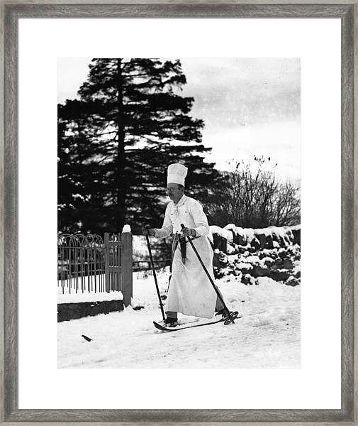 The Skiing Chef Framed Print by Fox Photos