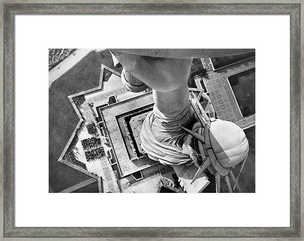 The Statue Of Liberty Still Holds High Framed Print