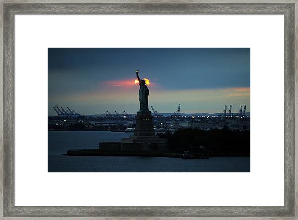 The Statue Of Liberty With The Sun Framed Print
