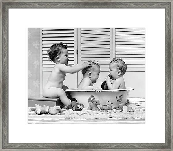 Three Babies In Wash Tub, Bathing Framed Print