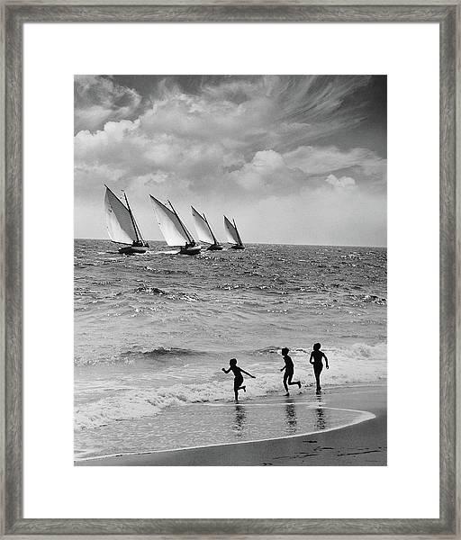Three Boys Running Along Beach Framed Print