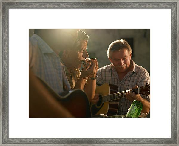 Three Men Playing Instruments At Sunset Framed Print by 10'000 Hours