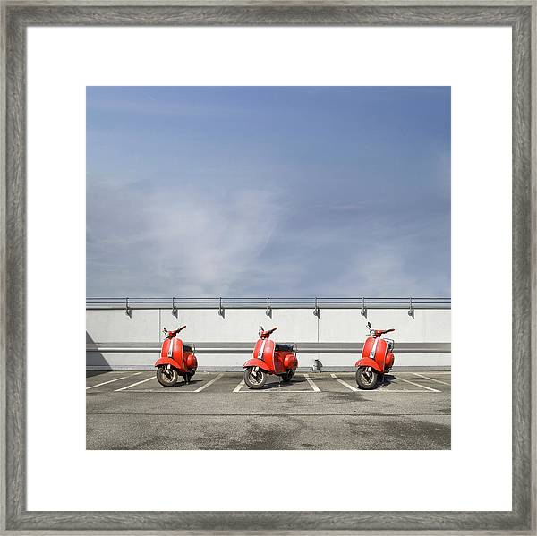 Three Red Motor Scooters At Parking Deck Framed Print