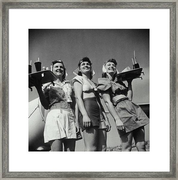 Three Smiling Waitresses Holding Trays Framed Print