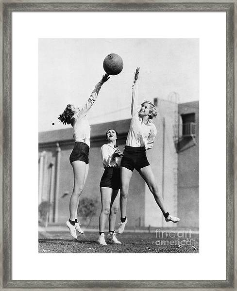 Three Women With Basketball In The Air Framed Print
