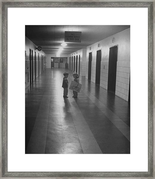 Three-yr-old Boy And Girl Talking In Emp Framed Print