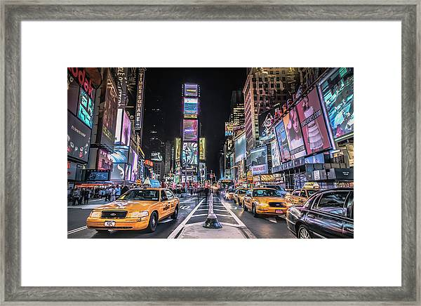 Times Square At Night With Famous Nyc Framed Print