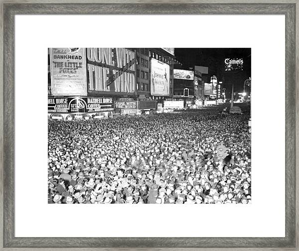 Times Square Is Filled With Celebrators Framed Print