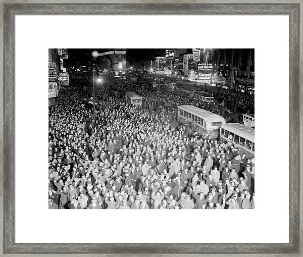 Times Square Is Packed With People Out Framed Print