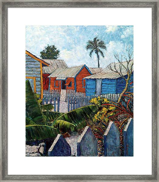 Tin Roofs And Clapboard Framed Print