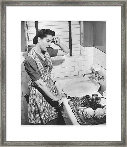 Tired Woman At Kitchen Sink, B&w Framed Print
