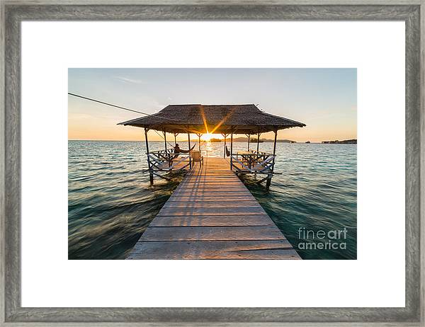 Tourist Sitting On Wooden Jetty While Framed Print