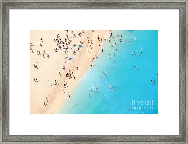 Tourists On The Sand Beach Of Navagio Framed Print