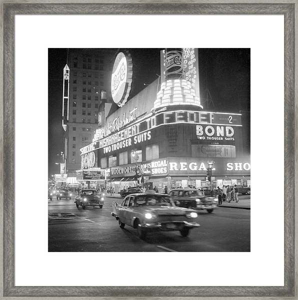 Traffic And Stores In Times Square Framed Print by Bettmann