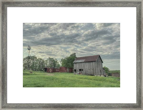 Train Cars And A Barn Framed Print