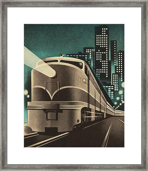 Train Leaving City Framed Print
