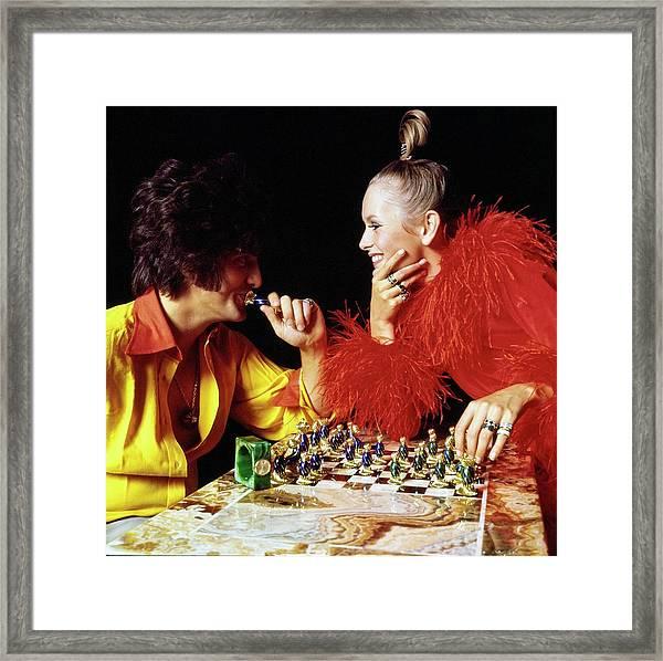 Twiggy And Justin De Villeneuve Play Chess, Vogue Framed Print by Bert Stern