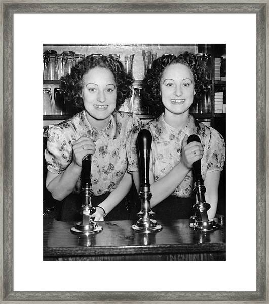 Twins Pull Pints Framed Print