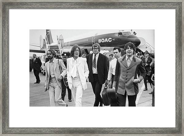 Two Beatles Arrive In New York Framed Print
