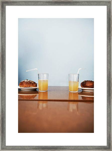 Two Cinnamon Buns And Two Glasses Of Framed Print by Johner Images