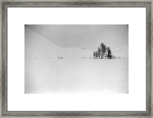Two Distant Figures Climbing Hill In A Framed Print
