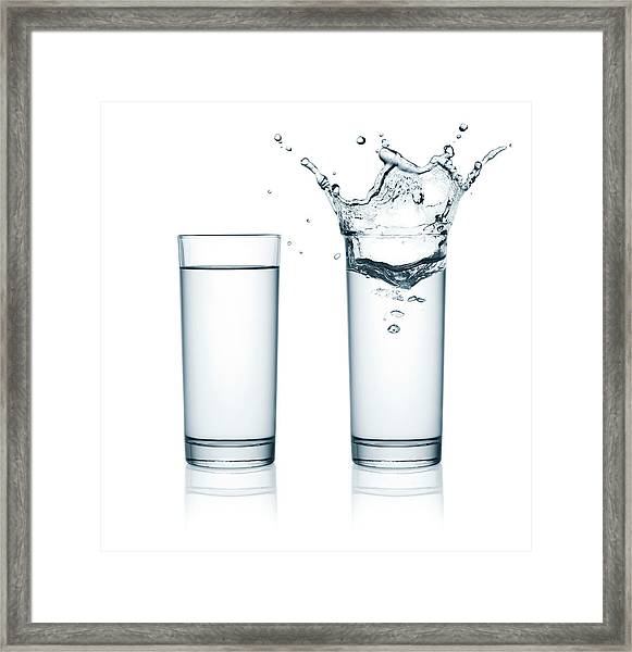 Two Glasses Of Water, One With Splashes Framed Print by Julichka