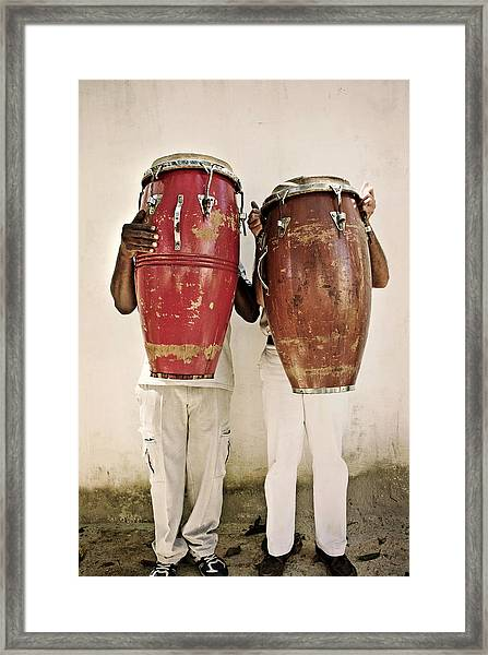 Two Men Holding Bongos In Front Of Framed Print by Holly Wilmeth