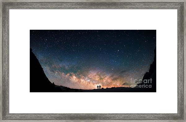 Two People Standing Together Holding Framed Print by Anton Jankovoy