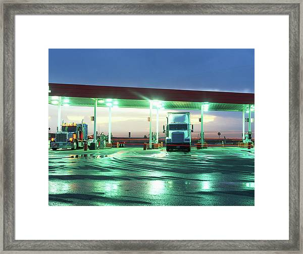Two Semi Trucks Parked At Gas Station Framed Print