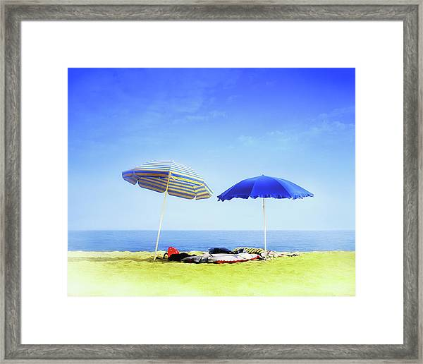 Two Sunshades Over Clothes, Towels And Framed Print