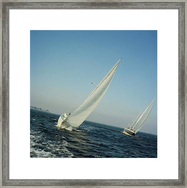 Two Yachts Sailing On Sea Framed Print