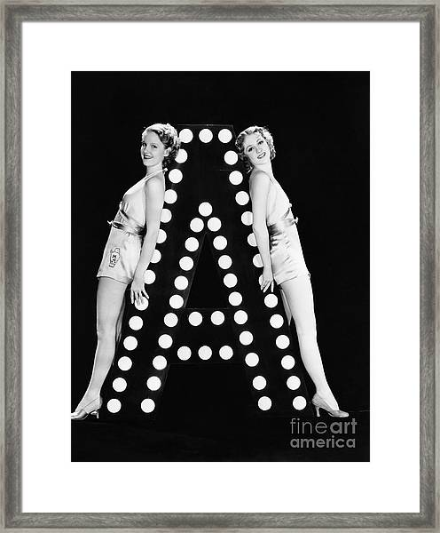 Two Young Women Posing With The Letter A Framed Print