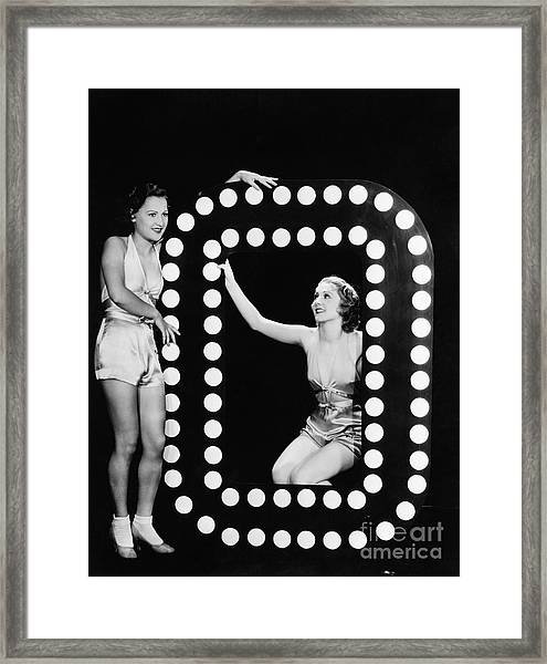 Two Young Women Posing With The Letter O Framed Print