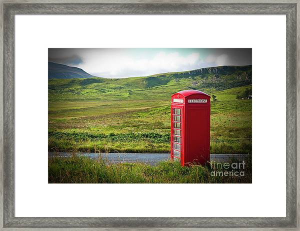 Typical Red English Telephone Box In A Rural Area Near A Road. Framed Print
