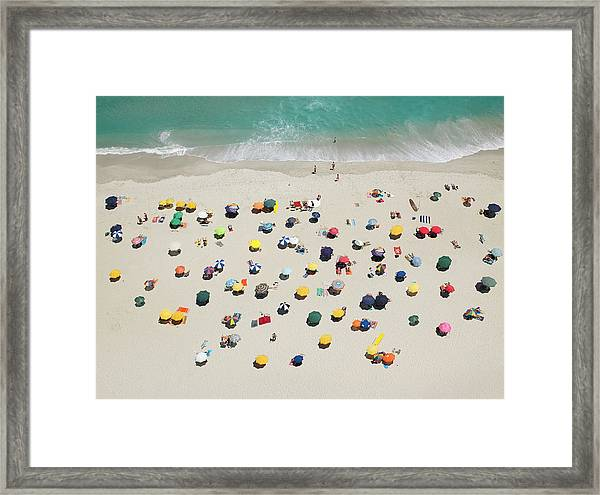 Umbrella Pattern On Beach Framed Print by Roger Wright