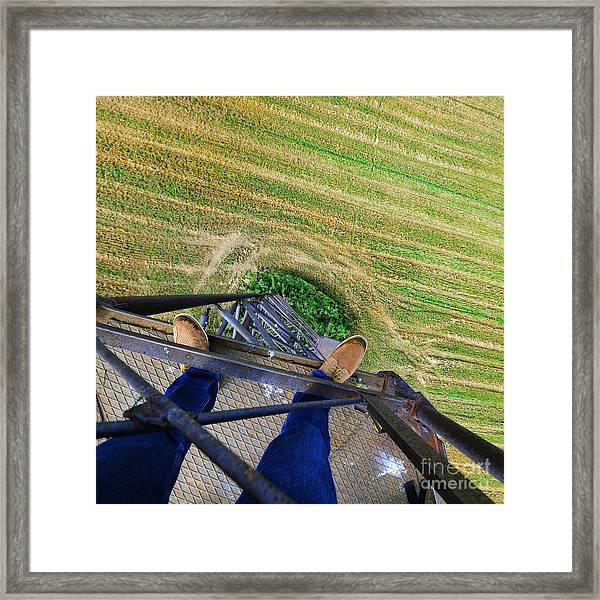 Urban Explorer Standing At The Top Of Framed Print