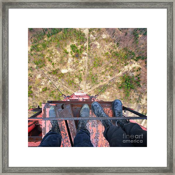 Urban Explorers Standing At The Top Of Framed Print