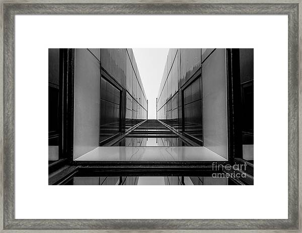 Urban Geometry, Looking Up To Glass Framed Print