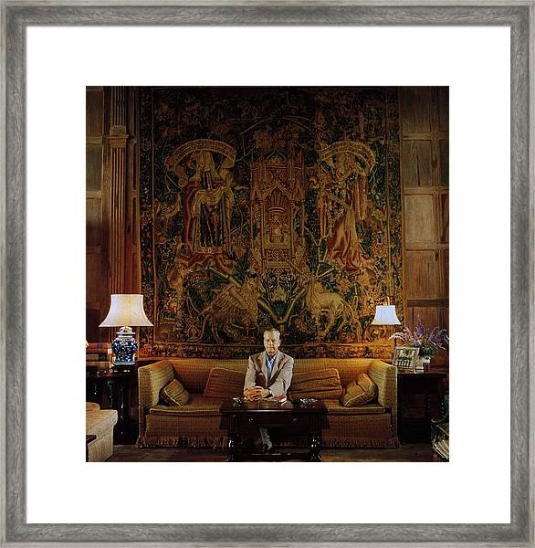 Vanderbilt At Home Framed Print by Slim Aarons