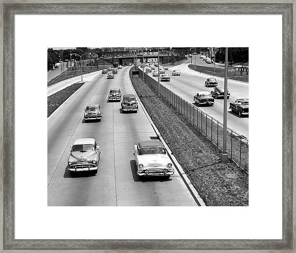 Various American Autos On Highway Framed Print by George Marks