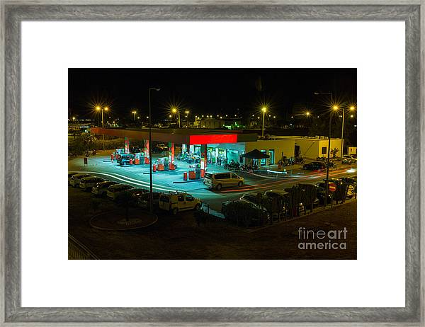 View Of A Urban Gas Station Working In Framed Print
