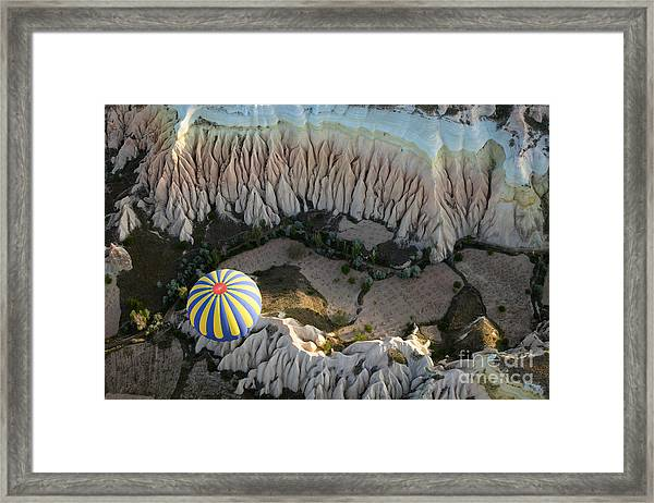 View Of The Air Balloon Flying Over Framed Print