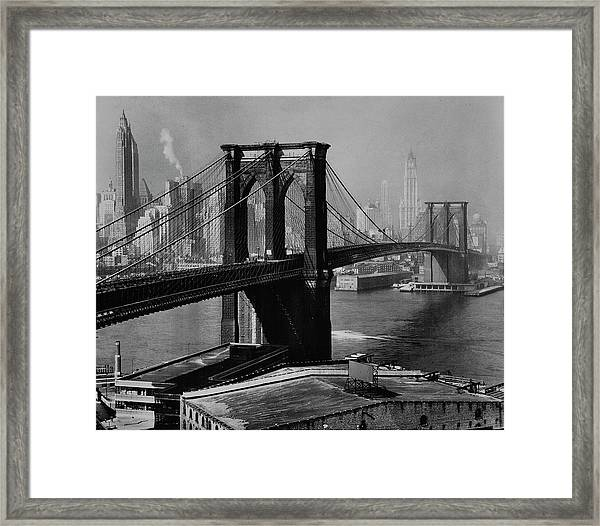 View Of The Brooklyn Bridge & The Skyscr Framed Print