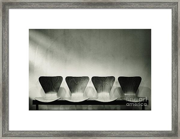 Waiting Room With Empty Wooden Chairs, Concept Of Waiting And Passage Of Time, Black And White Image, Free Space For Text. Framed Print