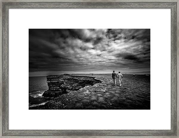 Walking To The Edge Framed Print