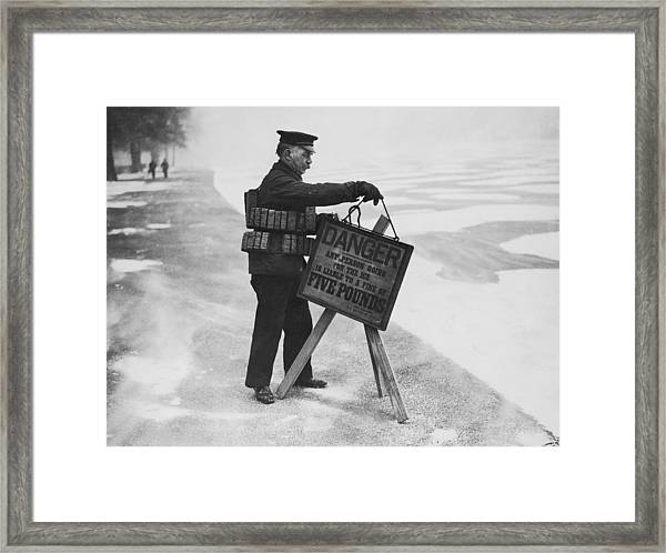 Warning And Fine Framed Print