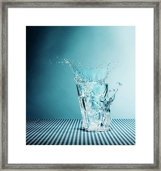 Water Splashing From Broken Glass Framed Print by Henrik Sorensen
