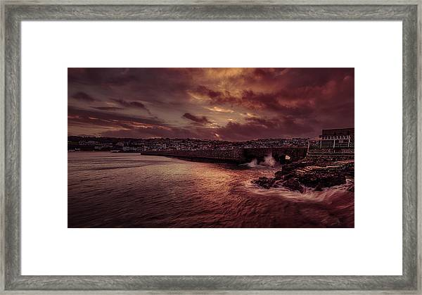 Wave At The Pier Framed Print